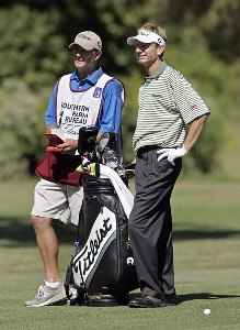 Brad Faxon with his caddie on the 14th hole during the second round of the Southern Farm Bureau Classic at Annandale Golf Club in Madison, Mississippi, on September 29, 2006. Photo by Hunter Martin/WireImage.com