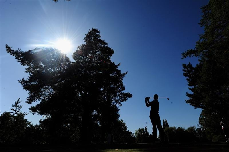 PARIS - SEPTEMBER 25:  Nick Dougherty of the Great Britian and Northern Ireland team plays his tee shot on the 12th hole during the second day fourball at The Vivendi Trophy with Severiano Ballesteros at Saint - Nom - La Breteche golf course on September 25, 2009 in Paris, France.  (Photo by Stuart Franklin/Getty Images)