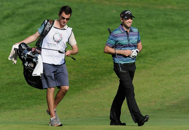 VILLAMOURA, PORTUGAL - OCTOBER 16:  Oliver Wilson of England and caddie on the 18th hole during the third round of the Portugal Masters at the Oceanico Victoria Golf Course on October 16, 2010 in Villamoura, Portugal.  (Photo by Stuart Franklin/Getty Images)