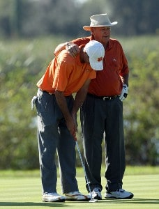 Sam Saunders stands with his grandfather Arnold Palmer on the green at the 5th hole during the final round of the 2007 Del Webb Father Son Challenge on the International Course at Champions Gate Golf Club, on December 2, 2007 in Champions Gate, Florida, Champions Tour - Del Webb Father-Son Challenge - Final RoundPhoto by David Cannon/WireImage.com