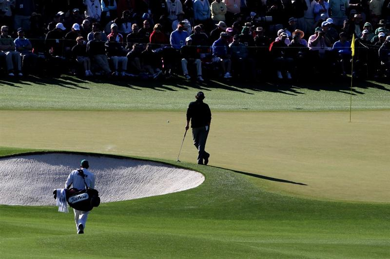 AUGUSTA, GA - APRIL 09:  Jason Dufner waits with his caddie Kevin Baile on the second hole during the second round of the 2010 Masters Tournament at Augusta National Golf Club on April 9, 2010 in Augusta, Georgia.  (Photo by Jamie Squire/Getty Images)