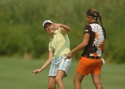 Marisa Baena shows Jennifer Rosales the stance she might need to use during the second round of the 2006 Wendy's Championship for Children held at Tartan Fields Golf Club in Dublin, Ohio on August 25, 2006.Photo by Steve Grayson/WireImage.com