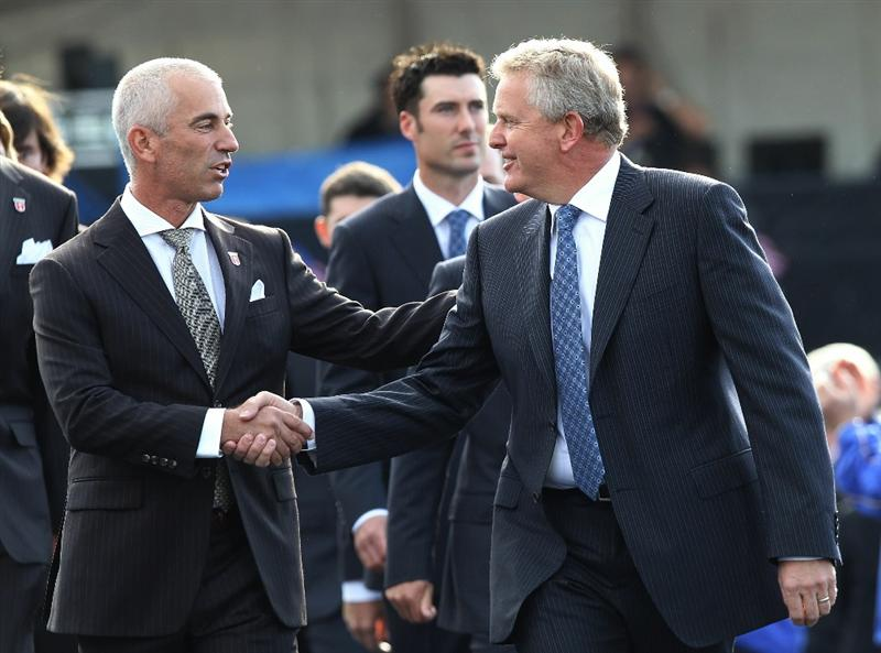 NEWPORT, WALES - SEPTEMBER 30:  Team Captains Corey Pavin (L) of the USA and Colin Montgomerie of Europe shake hands during the Opening Ceremony prior to the 2010 Ryder Cup at the Celtic Manor Resort on September 30, 2010 in Newport, Wales. (Photo by Ross Kinnaird/Getty Images)