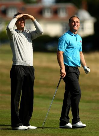 SUNNINGDALE, ENGLAND - SEPTEMBER 04:  Wallace Booth of Scotland (r) talks with former Walker Cup player and European Tour Pro Nick Dougherty of England during a GB&I Walker Cup Practice round at Sunningdale Golf Club on September 4, 2009 in Sunningdale, England.  (Photo by Richard Heathcote/Getty Images)