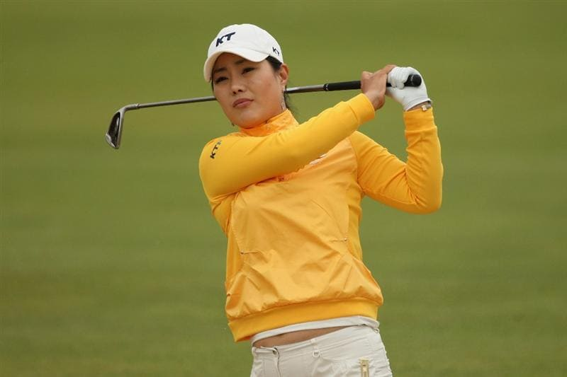 LYTHAM ST ANNES, UNITED KINGDOM - JULY 31:  Meena Lee of Korea hits an approach shot during the second round of the 2009 Ricoh Women's British Open Championship held at Royal Lytham St Annes Golf Club, on July 31, 2009 in  Lytham St Annes, England. (Photo by Warren Little/Getty Images)