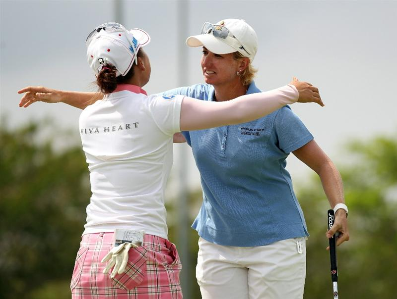 SINGAPORE - FEBRUARY 27:  Karrie Webb of Australia is congratulated by Chie Arimura of Japan during the final round of the HSBC Women's Champions at Tanah Merah Country Club  on February 27, 2011 in Singapore, Singapore.  (Photo by Ross Kinnaird/Getty Images)