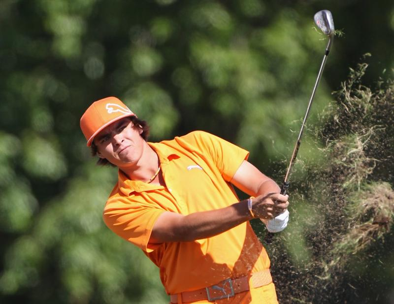 DORAL, FL - MARCH 13:  Rickie Fowler hits a shot from the rough on the 14th hole during the final round of the 2011 WGC- Cadillac Championship at the TPC Blue Monster at the Doral Golf Resort and Spa on March 13, 2011 in Doral, Florida.  (Photo by Sam Greenwood/Getty Images)