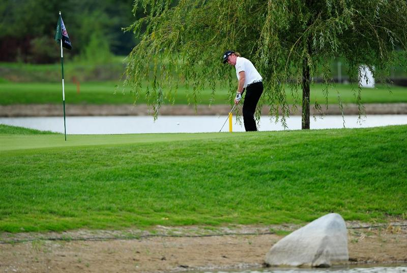 VIENNA, AUSTRIA - SEPTEMBER 18:  Miguel Angel Jimenez of Spain plays his approach shot on the 15th hole during the third round of the Austrian golf open presented by Botarin at the Diamond country club on September 18, 2010 in Atzenbrugg near Vienna, Austria.  (Photo by Stuart Franklin/Getty Images)