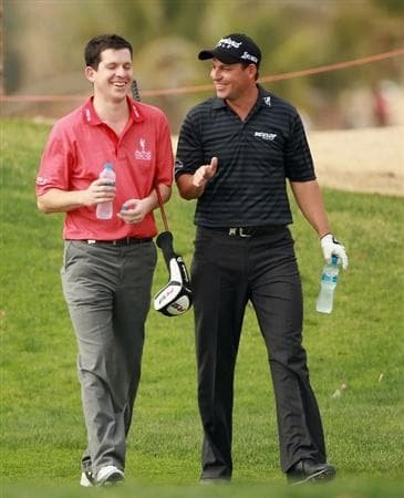 ABU DHABI, UNITED ARAB EMIRATES - JANUARY 19:  Tim Henman, former Engish tennis star, (left) shares a joke with David Howell of England during the Pro Am prior to the start of The Abu Dhabi HSBC Golf Championship at Abu Dhabi Golf Club on on January 19, 2011 in Abu Dhabi, United Arab Emirates.  (Photo by Andrew Redington/Getty Images)
