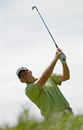 PARKER, CO - MAY 27:   Tom Lehman tee off the par three 2nd hole  during the first round of the Senior PGA Championship at the Colorado Golf Club  on May 27, 2010 in Parker, Colorado.  (Photo by Marc Feldman/Getty Images)