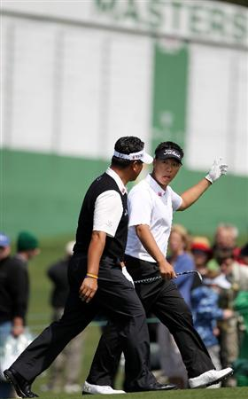 AUGUSTA, GA - APRIL 05:  K.J. Choi (L) and amateur Lion Kim of South Korea walk to a green during a practice round prior to the 2011 Masters Tournament at Augusta National Golf Club on April 5, 2011 in Augusta, Georgia.  (Photo by Jamie Squire/Getty Images)
