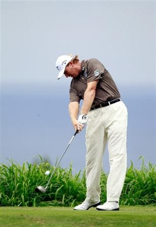 KAPALUA, HI - JANUARY 07:  Ernie Els of South Africa hits a shot on the 16th hole during the second round of the Hyundai Tournament of Champions at the Plantation course on January 7, 2011 in Kapalua, Hawaii.  (Photo by Sam Greenwood/Getty Images)
