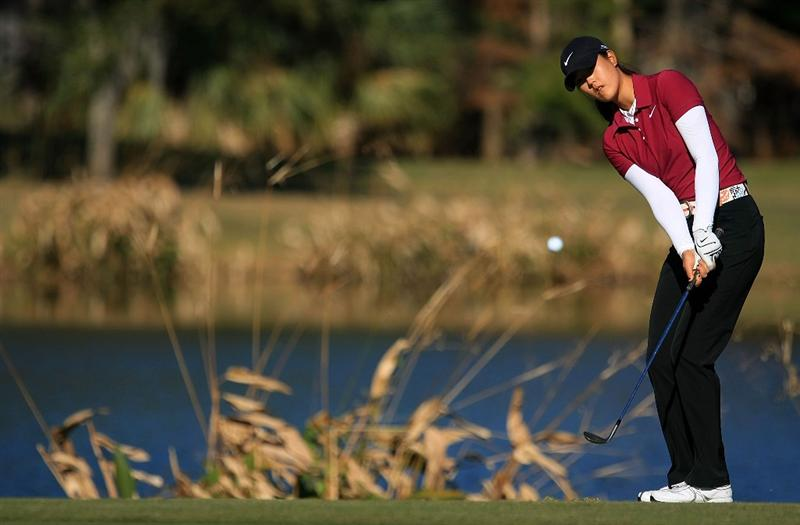 DAYTONA BEACH, FL - DECEMBER 07:  Michelle Wie hits a pitch shot on the 17th hole during the final round of the LPGA Qualifying School at LPGA International on December 7, 2008 in Daytona Beach, Florida.  (Photo by Scott Halleran/Getty Images)