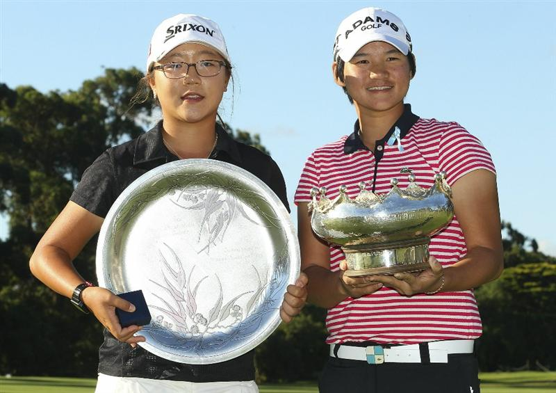 MELBOURNE, AUSTRALIA - FEBRUARY 06:  Lydia Ko of New Zealand holds the leading amateur trophy and Yani Tseng of Taiwan holds the trophy after winning the Women's Australian Open at The Commonwealth Golf Club on February 6, 2011 in Melbourne, Australia.  (Photo by Lucas Dawson/Getty Images)