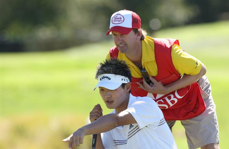 CHRISTCHURCH, NEW ZEALAND - MARCH 07:  Danny Lee of New Zealand maps out a shot with his caddie during day three of the New Zealand PGA Championship at Clearwater Golf Club on March 7, 2009 in Christchurch, New Zealand.  (Photo by Marty Melville/Getty Images)