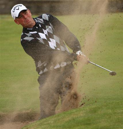 CARNOUSTIE, SCOTLAND - OCTOBER 02:  Thomas Bjorn of Denmark plays his fourth shot on the 18th hole during the second round of The Alfred Dunhill Links Championship at Carnoustie Golf Club on October 2, 2009 in Carnoustie, Scotland. (Photo by Andrew Redington/Getty Images  (Photo by Andrew Redington/Getty Images)