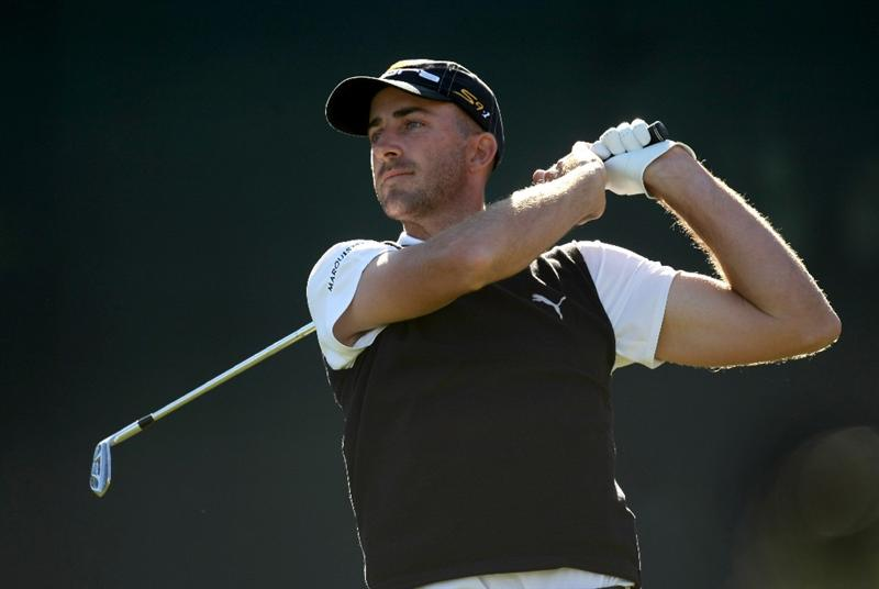 SCOTTSDALE, AZ - FEBRUARY 1:  Geoff Ogilvy of Australia hits his tee shot on the 16th hole during the final round of the FBR Open on February 1, 2009 at TPC Scottsdale in Scottsdale, Arizona.  (Photo by Stephen Dunn/Getty Images)
