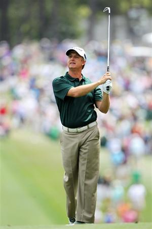 AUGUSTA, GA - APRIL 10:  David Toms watches his approach shot on the first hole during the third round of the 2010 Masters Tournament at Augusta National Golf Club on April 10, 2010 in Augusta, Georgia.  (Photo by Jamie Squire/Getty Images)