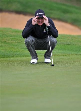 PARIS - SEPTEMBER 24:  Jarmo Sandelin of Sweden lines his putt at the eighteenth hole during day two of the Vivendi cup at Joyenval Golf course on September 24, 2010 outside Paris, France.  (Photo by Pascal Le Segretain/Getty Images)