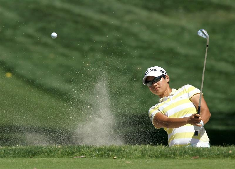 RANCHO MIRAGE, CA - APRIL 04:  Yani Tseng of Taiwan hits out of a bunker on the 11th hole during the final round of the Kraft Nabisco Championship at Mission Hills Country Club on April 4, 2010 in Rancho Mirage, California.  (Photo by Stephen Dunn/Getty Images)