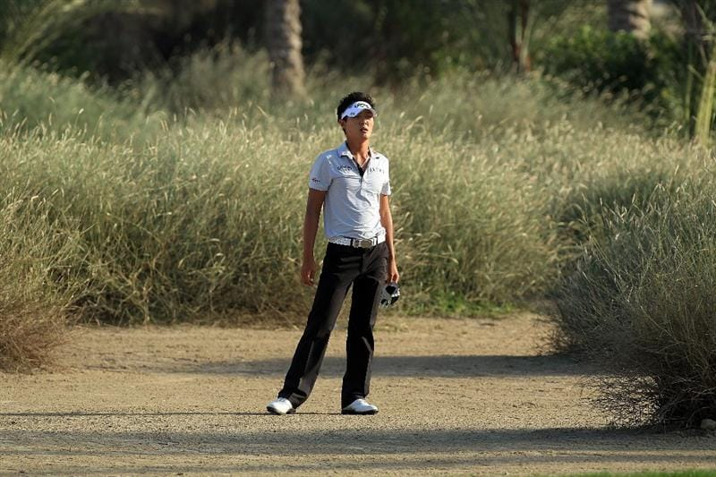 DUBAI, UNITED ARAB EMIRATES - FEBRUARY 03: Danny Lee of New Zealand walks through long grass from the 16th tee during the pro-am for the 2010 Omega Dubai Desert Classic on the Majilis Course at the Emirates Golf Club on February 3, 2010 in Dubai, United Arab Emirates.  (Photo by David Cannon/Getty Images)