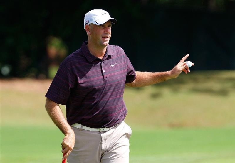 ATLANTA, GEORGIA - SEPTEMBER 24:  Stewart Cink acknowledges the gallery after sinking a birdie putt on the third green during the first round of THE TOUR Championship presented by Coca-Cola, the final event of the PGA TOUR Playoffs for the FedExCup, at East Lake Golf Club on September 24, 2009 in Atlanta, Georgia.  (Photo by Kevin C. Cox/Getty Images)