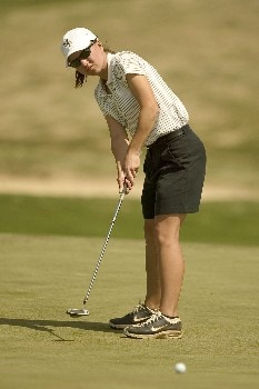 Wake Forest sophomore Mandy Goins watches the path of her putt on the 18th green during final round play of the 2005 ACC Women's Golf Championship at Carmel Country Club in Charlotte, NC, April 17, 2005.  Goins shot a 3-day total of 228 (+12) to finish in 7th place overall.Photo by Brian A.  Westerholt/WireImage.com
