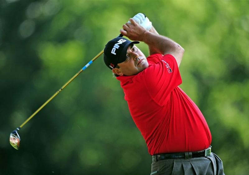 AKRON, OH - AUGUST 06:  Angel Cabrera of Argentina plays his tee shot on the 11th hole during the first round of the World Golf Championship Bridgestone Invitational on August 6, 2009 at Firestone Country Club in Akron, Ohio.  (Photo by Stuart Franklin/Getty Images)
