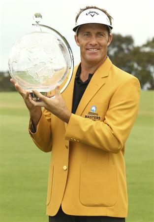 MELBOURNE, AUSTRALIA - NOVEMBER 14:  Stuart Appleby of Australia holds the trophy after winning the 2010 Australia Masters after round four of the Australian Masters at The Victoria Golf Club on November 14, 2010 in Melbourne, Australia.  (Photo by Lucas Dawson/Getty Images)