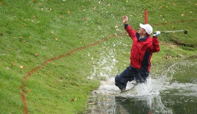 SEQUENCE Image no 8     Woody Austin of the U.S. Team plays his second shot from the water at the par 4, 14th hole during the round two fourball matches at the Presidents Cup at The Royal Montreal Golf Club September 28, 2007 in Montreal, Quebec, Canada.Photo by Scott Halleran/WireImage.com