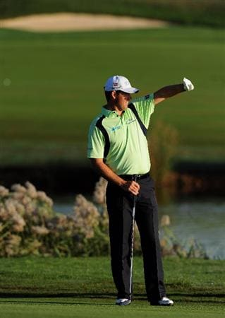 VILAMOURA, PORTUGAL - OCTOBER 15:  Padraig Harrington of Ireland watches his approach shot on the 12th hole during the first round of the Portugal Masters at the Oceanico Victoria Golf Course on October 15, 2009 in Vilamoura, Portugal.  (Photo by Stuart Franklin/Getty Images)