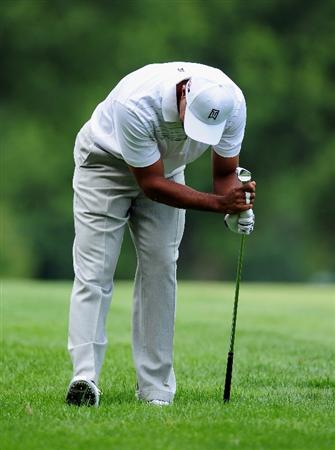 AKRON, OH - AUGUST 06:  Tiger Woods of the U.S. reacts to his approach shot on the 11th hole during the first round of the World Golf Championship Bridgestone Invitational on August 6, 2009 at Firestone Country Club in Akron, Ohio.  (Photo by Stuart Franklin/Getty Images)