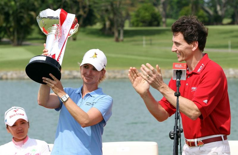 SINGAPORE - FEBRUARY 27:  Karrie Webb of Australia is presented with the winners trophy by Alex Hungate, CEO HSBC Singapore after the final round of the HSBC Women's Champions at Tanah Merah Country Club  on February 27, 2011 in Singapore, Singapore.  (Photo by Ross Kinnaird/Getty Images)