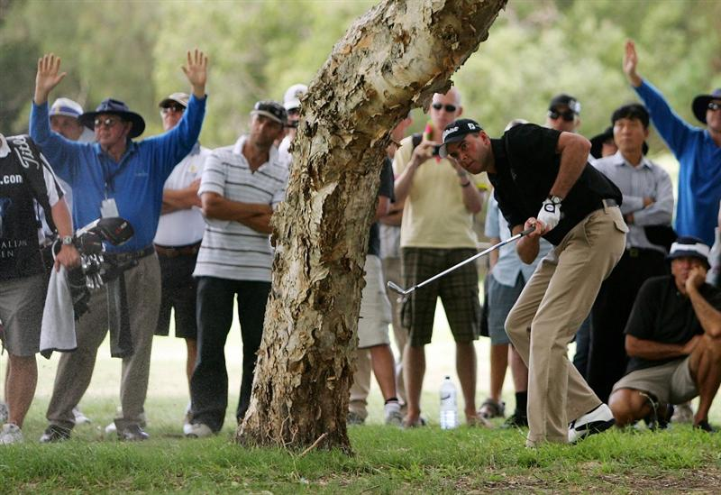 SYDNEY, AUSTRALIA - DECEMBER 14:  David Smail of New Zealand plays out of the rough on the tenth hole during the fourth round of the 2008 Australian Open at The Royal Sydney Golf Club on December 14, 2008 in Sydney, Australia.  (Photo by Mark Nolan/Getty Images)