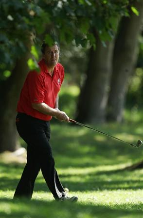 VIRGINIA WATER, ENGLAND - MAY 25:  Matt Le Tissier hits out of trouble during the Pro-Am round prior to the BMW PGA Championship at Wentworth Club on May 25, 2011 in Virginia Water, England.  (Photo by Warren Little/Getty Images)