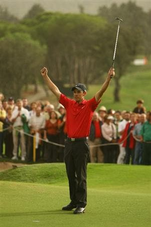 MADRID, SPAIN - OCTOBER 12:  Charl Schwartzel of South Africa celebrates after winning the  Final round of the Madrid Masters at the Club de Campo Villa de Madrid on October 12, 2008 in Madrid, Spain.  (Photo by Ian Walton/Getty Images)