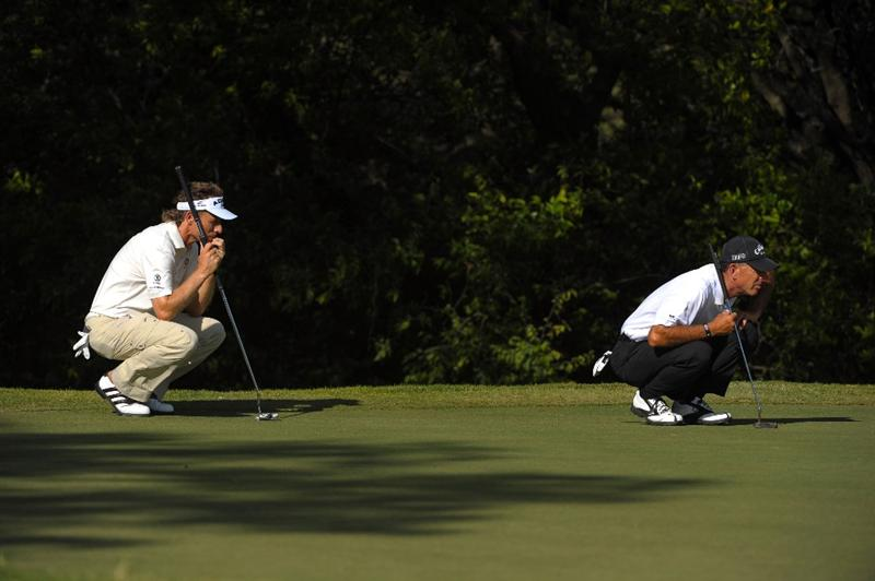 SAN ANTONIO - OCTOBER 25:  Bernhard Langer (L) of Germany and Chip Beck aims for a putt on the 17th hole during the final round of the PGA Champions Tour AT&T Championship at the Oak Hills Country Club on October 25, 2009 in San Antonio, Texas.  (Photo by Robert Laberge/Getty Images)
