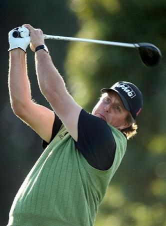 LA JOLLA, CA- JANUARY 26:  Phil Mickelson tees off the 18th hole during the Pro-Am at the Farmers Insurance Open at Torrey Pines on January 26, 2011 in La Jolla, California. (Photo by Donald Miralle/Getty Images)