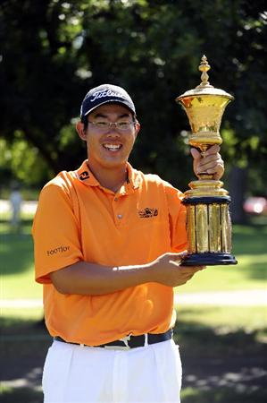 TULSA, OK - AUGUST 30:  Byeong-Hun An poses with the trophy after winning the Finals of the U.S. Amateur Golf Championship on August 30, 2009 at Southern Hills Country Club in Tulsa, Oklahoma.  (Photo by G. Newman Lowrance/Getty Images)