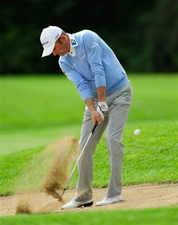 VIENNA, AUSTRIA - SEPTEMBER 16:  Markus Brier of Austria plays his bunker shot on the seventh hole during the first round of the Austrian golf open presented by Botarin at the Diamond country club on September 16, 2010 in Atzenbrugg near Vienna, Austria.  (Photo by Stuart Franklin/Getty Images)