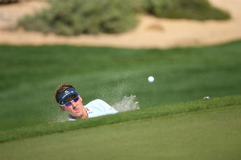 MARANA, AZ - FEBRUARY 19:  Ian Poulter of England plays his third shot out of the bunker on the seventh hole during round three of the Accenture Match Play Championship at the Ritz-Carlton Golf Club on February 19, 2010 in Marana, Arizona.  (Photo by Hunter Martin/Getty Images)