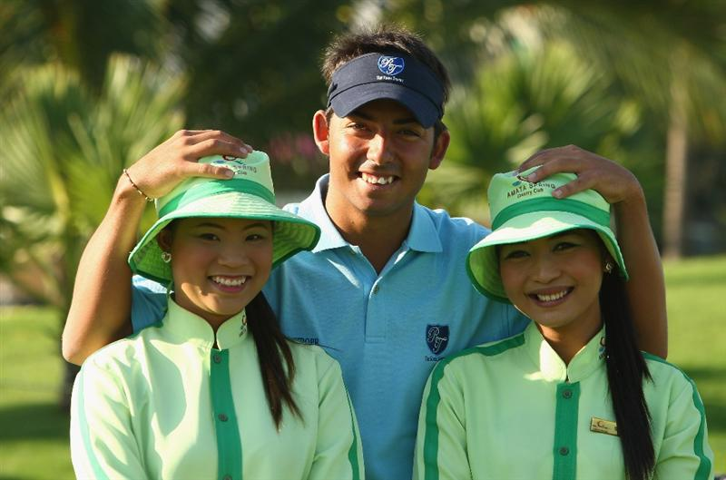 BANGKOK, THAILAND - JANUARY 08: Pablo Larrazabal of Spain and two of the local caddies pose for a photograph on the 1st hole during The Royal Trophy Pro-Am at the Amata Spring Country Club on January 8, 2009 in Bangkok, Thailand.  (Photo by Ian Walton/Getty Images)