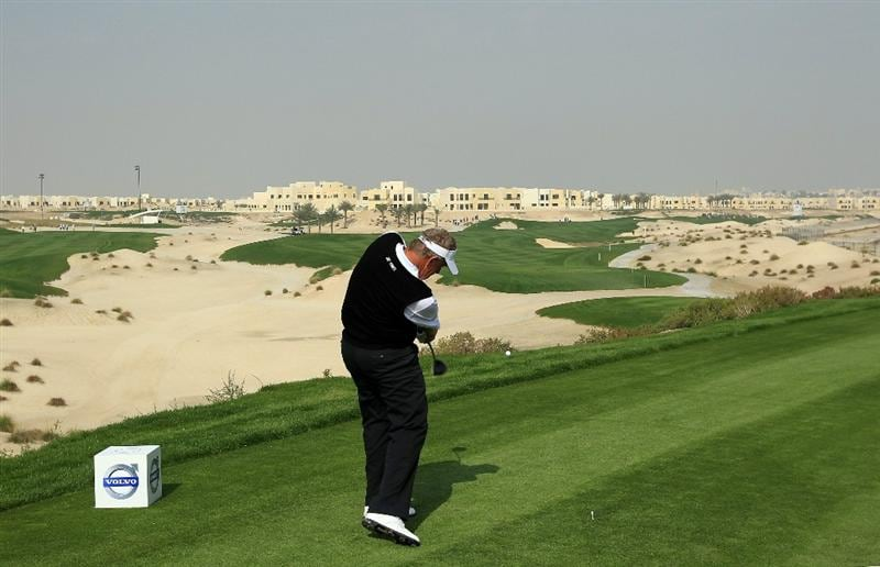 BAHRAIN, BAHRAIN - JANUARY 27:  Colin Montgomerie of Scotland plays his tee shot at the 3rd hole during the first round of the 2011 Volvo Champions held at the Royal Golf Club on January 27, 2011 in Bahrain, Bahrain.  (Photo by David Cannon/Getty Images)