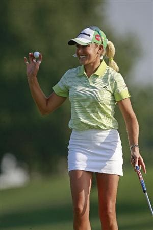 ROGERS, AR - SEPTEMBER 11: Natalie Gulbis waves after making a birdie on the first hole during first round play in the P&G Beauty NW Arkansas Championship at the Pinnacle Country Club on September 11, 2009 in Rogers, Arkansas.  (Photo by Dave Martin/Getty Images)