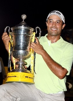 KUALA LUMPUR, MALAYSIA - MARCH 09:  Arjun Atwal of India with the winners trophy after the final round of the Maybank Malaysian Open held at the Kota Permai Golf & Country Club on March 9, 2008 in Kuala Lumpur, Malaysia  (Photo by Ross Kinnaird/Getty Images)