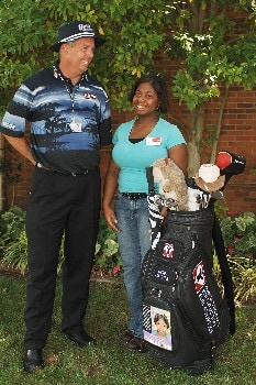 Kirk Triplett meets with  'Mariah' after his first round of play at the 2005 Bank of America Colonial. Triplett annouced 'Tore For Adoption' a new program created by the Triplett Family, with the Dave Thomas Foundation for adoption to promote the need to place America's foster children in permanent loving homes.Photo by Steve Grayson/WireImage.com