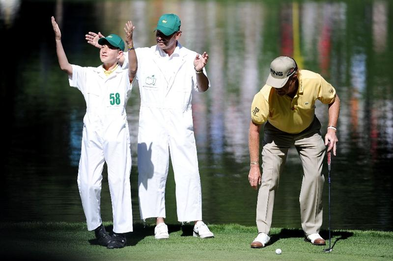 AUGUSTA, GA - APRIL 06:  Miguel Angel Jimenez of Spain (R) waits with his caddie and leading matador Pepin Liria (C) and son Victor (L) during the Par 3 Contest prior to the 2011 Masters Tournament at Augusta National Golf Club on April 6, 2011 in Augusta, Georgia.  (Photo by Harry How/Getty Images)