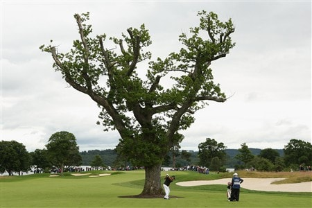 LUSS, UNITED KINGDOM - JULY 10:  Andres Romero of Argentina hits an approach shot on the 1st hole during the First Round of The Barclays Scottish Open at Loch Lomond Golf Club on July 10, 2008 in Luss, Scotland. (Photo by Warren Little/Getty Images)