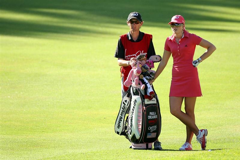 GUADALAJARA, MX - NOVEMBER 16: Paula Creamer of the United States stands with her caddie Colin Cann on the 18th hole during the final round of the Lorena Ochoa Invitational at Guadalajara Country Club on November 16, 2008 in Guadalajara, Mexico. (Photo by Hunter Martin/Getty Images)