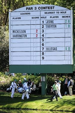 AUGUSTA, GA - APRIL 06:  Luke Donald of England walks past a leaderboard during the Par 3 Contest prior to the 2011 Masters Tournament at Augusta National Golf Club on April 6, 2011 in Augusta, Georgia.  (Photo by Harry How/Getty Images)